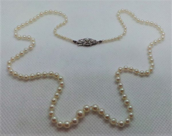 "Pearl necklace, 20"" long"