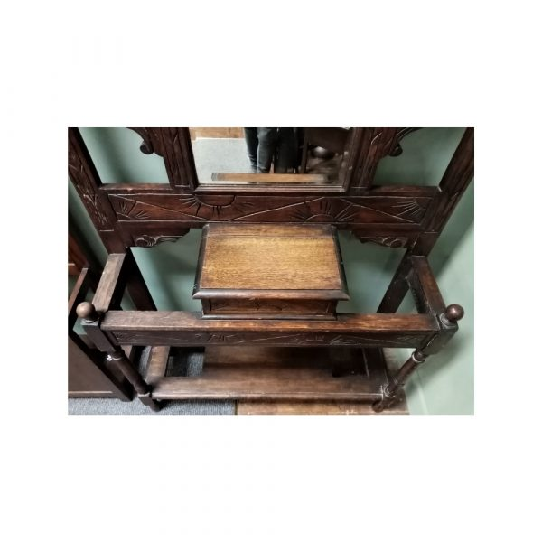 Carved oak hall stand with hooks