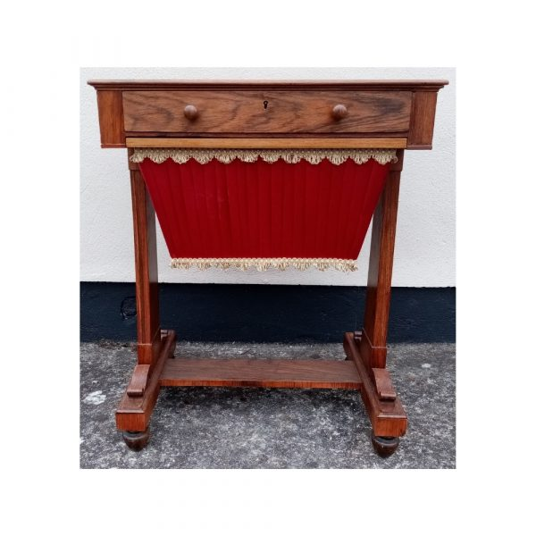 Sewing table with red under basket